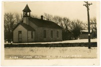 The old District No. 18 school at Dover is seen in this real photo postcard, circa 1910.
