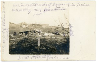 This real photo postcard view of the Haines home, demolished by a tornado, has handwritten notes noting directions in the view from April of 1911.