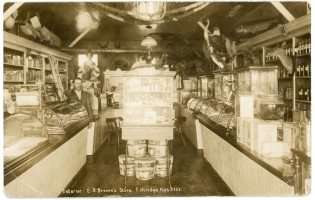 This interior view of E. R. Brown's drugstore in Eskridge dates from about 1910. This photo card was produced by C. U. Williams.