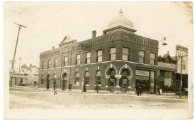 This 1911 view of the Waugh Building in Eskridge shows the Walker house at the far left when the house still had a turret on the roof.