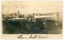 This view of the Alma Salt Works was probably produced by an unidentified studio from an original photograph that was taken in about 1874-1877. This card was probably produced in about 1910, some 35-years after the photo was taken.