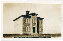"When this real photo postcard was created in about 1909, the ""old school"" at Alma had been closed for three years."