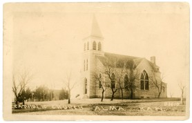 The Holy Family Catholic Church, seen in this Zercher real photo postcard, was constructed in Alma in 1899 after the first church was lost to fire.