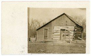 This real photo postcard shows the Henry Grimm cabin, located on the Grimm ranch at Volland. The card was sent by Volland merchant, Otto Kratzer to Henry Grimm's son, Joe Grimm, in 1915.