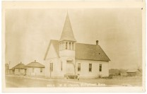 The M. E. Church in McFarland, Kansas was located on Main Street when the photo for this 1912 postcard was taken.