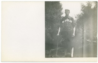 An unidentified ball player for the McFarland team poses for this real photo postcard.