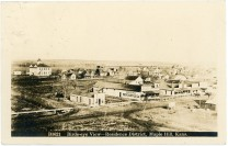 This 1914 birds-eye view of Maple Hill, Kansas was taken from the grain elevator for this Zercher real photo postcard mailed to Hamburg, Germany.