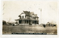 This real photo postcard by photographer J. Bowers, shows the Frank Adams residence at Maple Hill, Kansas.