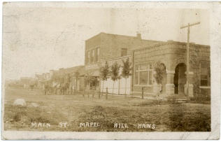 This real photo postcard by Zercher, shows the west side of the 200 block of Main Street in Maple Hill, Kansas in 1909.