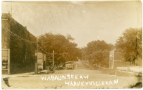 This real photo postcard showing Wabaunsee Avenue in Harveyville, Kansas dates from about 1915.