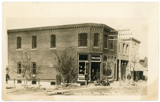 This real photo postcard by Zercher Book and Stationery Company shows the Corner Drug Store in Alta Vista, Kansas. Notice that the new Post Office, next door to the drug store, was under construction when this view was taken.