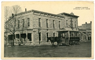The horse-drawn trolley is seen stopped in front of the Bank Hotel at Strong City in this photo postcard bearing a postmark of 1920.