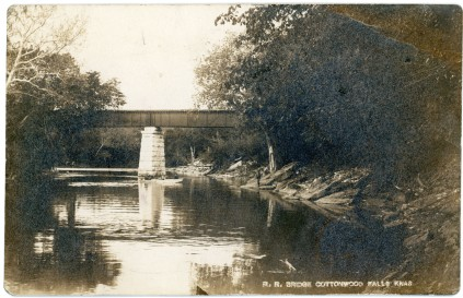 This real photo postcard view of the ATSF railroad bridge at Cottonwood Falls dates from about 1910.
