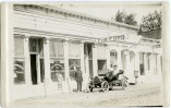 """This real photo postcard from Cottonwood Falls shows """"Uncle Billy Wolfrom's garage"""" and the Hoel Hardware Company in the spring of 1915. I donated this card to the Kansas State Historical Society after making my scan."""