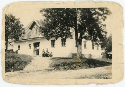 The Johann Meditz family home at Buchel is seen in this photo dated October 10, 1941. Johann's son, Rudolf, is seen standing in the doorway while Johann is seated with Rudolf's wife on the bench.