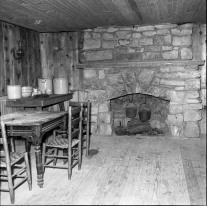 This interior photo of the log cabin at Ozarka Village shows the massive fireplace located in the east end of the building.