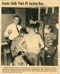 This view from the West Plains Daily Quill, taken in about 1966, shows Daddy teaching members of Boy Scout Troop 61 about prehistoric Indian artifacts.