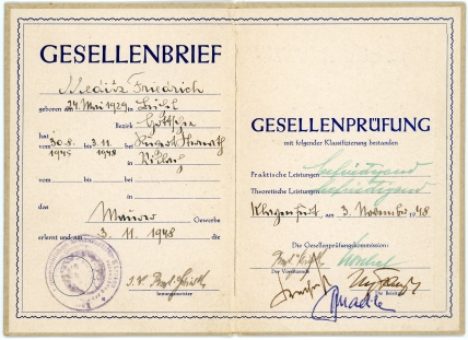 This graduation certificate, dated November 3, 1948 signifies Friedrich Meditz's completion of three years of school to become a journeyman stone mason. Friedrich was living at the Villach Displaced Persons Camp while he received his training as a mason.