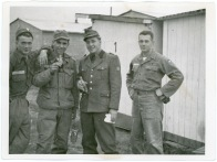 Fred Meditz, second from left, relaxes with other soldiers, enjoying a Coca-Cola at the Army camp at Neu-Ulm Germany, circa 1954-1956.