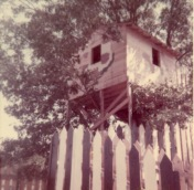 The tree house had a wide wooden stairway which lead into the top of a large oak tree at Ozarka Village.