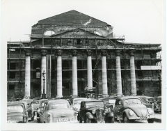 An estimated 85% of the buildings in Villach, Austria, suffered damage from British bombing during World War II. In this view, masons have constructed scaffolding on a damaged building.