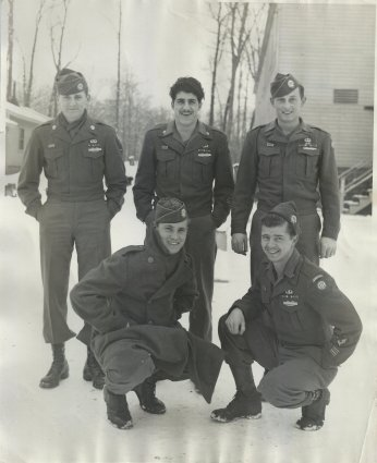 Brothers in Arms, five members of the 82nd Airborne pose for a photographer in front of a barracks building at Jefferson Barracks, at St. Louis in December of 1945. George Spartichino stands on the back row, center with Charlie Barnhart on the back row, far right. Notice the AA arm patch on the soldier squatting at the lower right. This was the insignia of the 82nd Airborne, signifying the Division's makeup of men from all 48 states, making it the truly All-American division.
