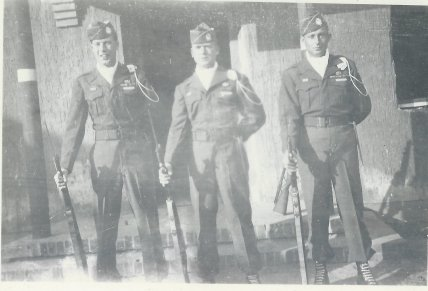 Pfc. Charlie Barnhart, far right, and two other members of the Escort Company stand at rest outside an American sector facility in Berlin in 1945.