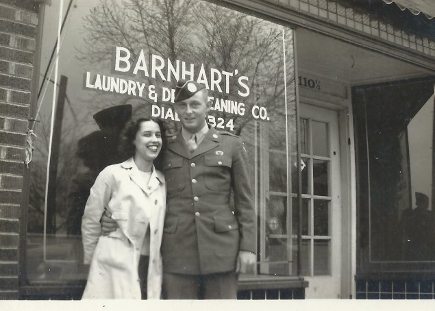 In this 1946 photo, Reba and Charlie Barnhart stand in front of Barnhart's Laundry & Dry Cleaning Co, owned by Turner Barnhart and located at 110 N 9th Street in Columbia, Missouri.