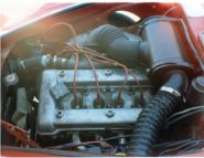 The 1300cc Alfa Romeo twin cam engine features twin dual throat Weber carburetors and steel header pipes. The 74-cubic-inch engine produced an impressive 90 horsepower.