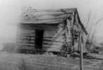 This log cabin, owned by George Vannatta, was built in the late 1850s at Chalk Mound in southwest Wabaunsee County. In addition to living in the cabin, Vannatta operated a store in the building. The Post Office was also located in this cabin.