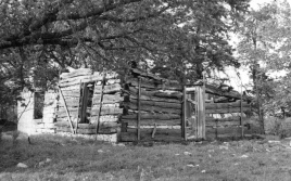 This log cabin and a stone addition added later were once the homestead of Gustav C. F. and Fredricka Hauer Schultz. The Schultz family immigrated to the United States in 1872 where they settled in this cabin three miles southwest of Volland, Kansas. Photo courtesy Julie and Cleo Schultz.