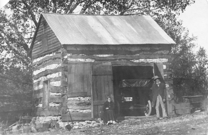 Sophia and William Horne pose in front of their homesteading cabin which the Hornes had converted to a garage when this photo was taken circa 1915. Photo courtesy Tony Meseke