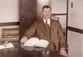 "County Attorney, Edward W. ""Butch"" Stuewe, seated in his office in the Wabaunsee County Courthouse, was the longest-serving County Attorney in history, holding that post for a quarter of a century. Photo courtesy Jeff and Deb Stuewe"