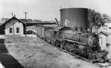 An ATSF steam engine stops for water at the Santa Fe depot at Alma, Kansas.