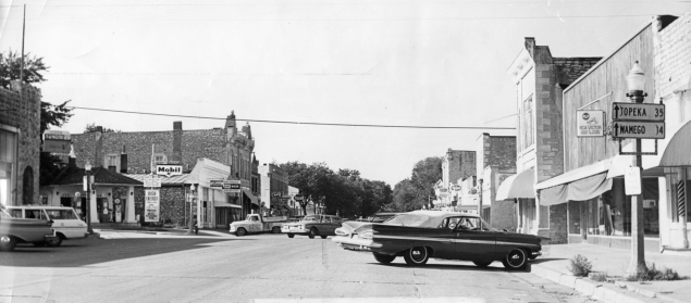 This 1965 view of the Alma, Kansas business district looks north at the intersection of 3rd and Missouri Streets.