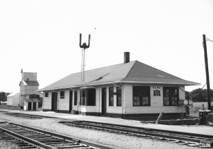 This Rock Island depot at Alma was constructed in 1918 after fire destroyed the former depot. The CO-OP elevator is visible in the background.