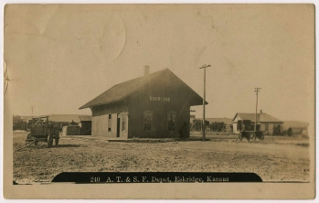 This real photo postcard by Zercher Photo in Topeka provides a view of the original MAB/ATSF depot at Eskridge, Kansas, before the depot was extended in length by 15-feet.