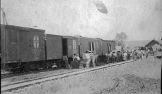 This photo from the Dean Dunn collection shows an ATSF train loading and unloading freight at the Eskridge, Kansas depot, circa 1900.