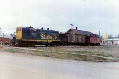 Eskridge merchant, Dean Dunn, took this photo of the last train departing the Eskridge, Kansas ATSF depot before the rail line closed.