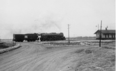 The Rock Island depot at Maple Hill, Kansas is visible at the far right of this 1960s view.