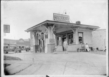 "Cloice Meeker, standing in driveway, purchased this gas station from Harold Duff in early 1931. This ""White Way Service Station"" was located at 122 S. Main Street in Eskridge."
