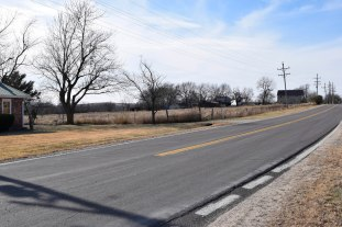 Van Newell's gas station was located approximately where this driveway meets K-99 Highway, on the east edge of Eskridge, Kansas.