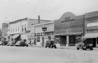 The Royal Cafe was located in the fifth storefront from the right in this 1930s view of the west side of the 100 block of South Main Street in Eskridge, Kansas.
