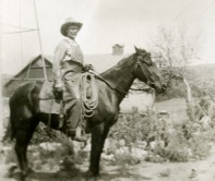 J. L. Schepp sits on horseback at his Illinois Creek ranch in this 1921 view. Notice his big barn in the background.