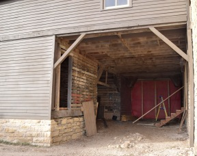In this view of the south entryway to the granary, one can see what appears to be rocks in the center of the entryway. These are actually the rock roof pieces of an arched-ceiling underground cave designed for water storage.