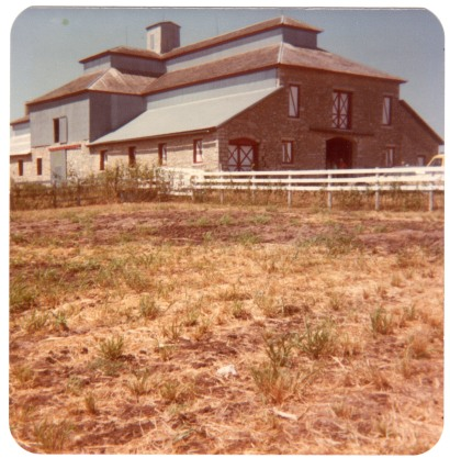 In this 1980s snapshot of the Wiser barn, one can see the modern window covers.