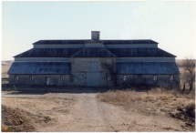 In this 1990 view of the Wiser Barn, one can see the outline of the stonework repair in the center section of the north side of the barn. A two-story section including the entry doors had collapsed.