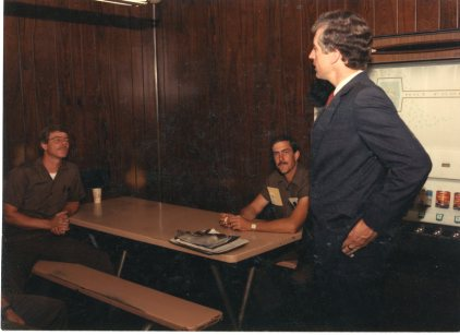 Congressman Jim Slattery speaks to package car drivers, Tom Shehi, left, and Dave Brown in the UPS center break room on Founders' Day, 1987.