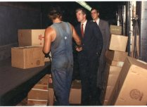 Congressman Jim Slattery meets with a UPS preloader as packages move down the conveyor at the UPS package car center in Topeka.