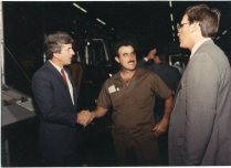 UPS manager, Bill Perry, right, introduces package car driver Ron Self to Congressman Jim Slattery on Founders' Day, 1987.
